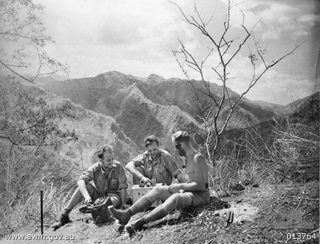 Three of the team who helped Max Loveless build Winnie the war winner re-enact transmissions from a hill in East Timor - Signaller Keith Richards, Corporal John Donovan and Lieutenant Jack Sergeant. Photo by Damien Parer