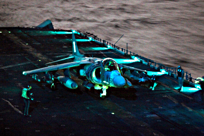An AV-8B Harrier jump jet returns to USS Kearsarge for fuel and ammunition resupply while conducting air strikes in support of Joint Task Force Odyssey Dawn, March 20, 2011. (USMC/Flickr)