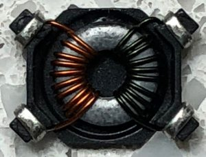 Inside the common mode choke clearly showing the two 51uH windings